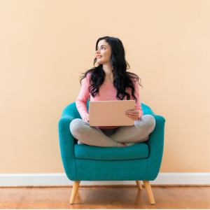 A girl sitting on sofa with laptop